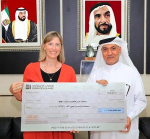 Awqaf-and-Minors-Affairs-Foundation-Hand-Over-a-Cheque